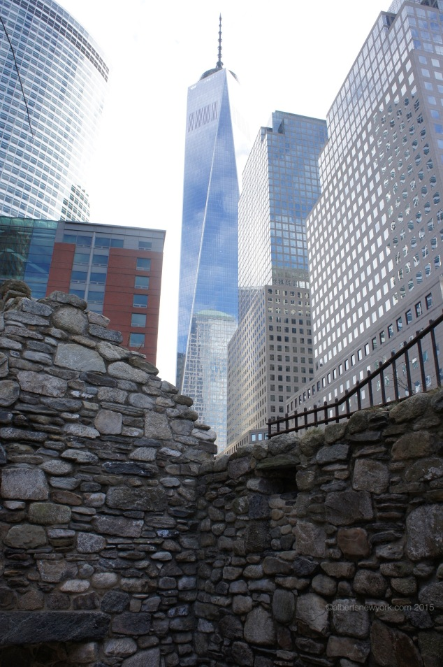One World Trade Center is up the street and visible from inside the memorial.